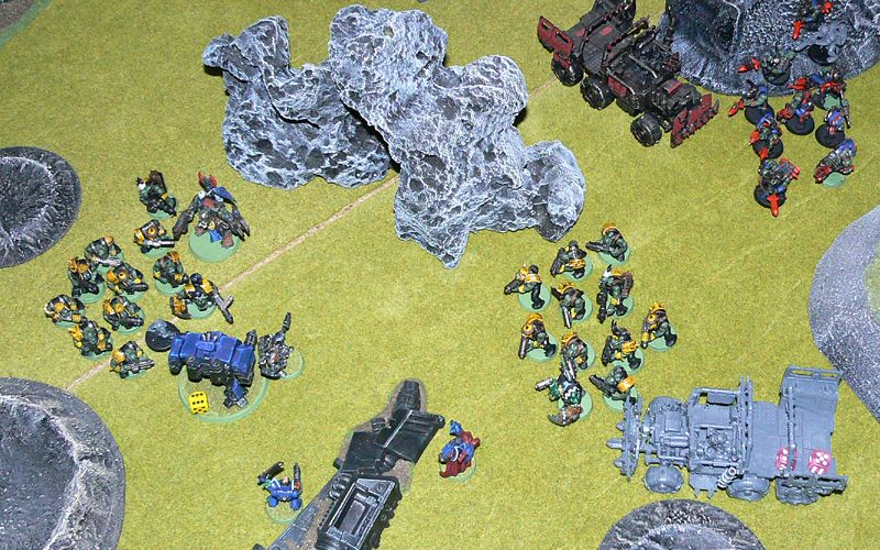 Orks swarm all over the surviving Space Marines